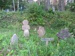 Шевино, реконструкция: каменные кресты
